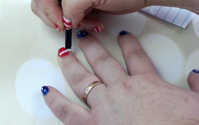4th of July Nail Art Tutorial Applying Stripes on southeastbymidwest.com #nails #nailart #beauty #bblogger #4thofjuly